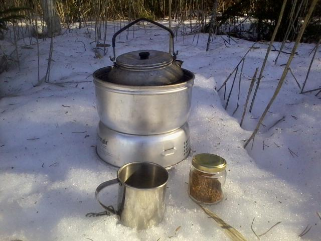 a portable stove burning alcohol