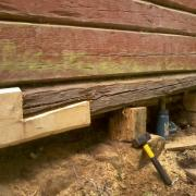 replacing bad parts at neighbour's log cabin
