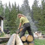 cutting leftover logs to make firewood
