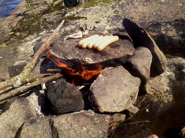 Cooking on a heated rock