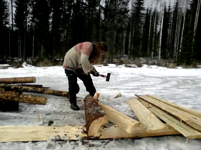 Hammering a wooden wedge