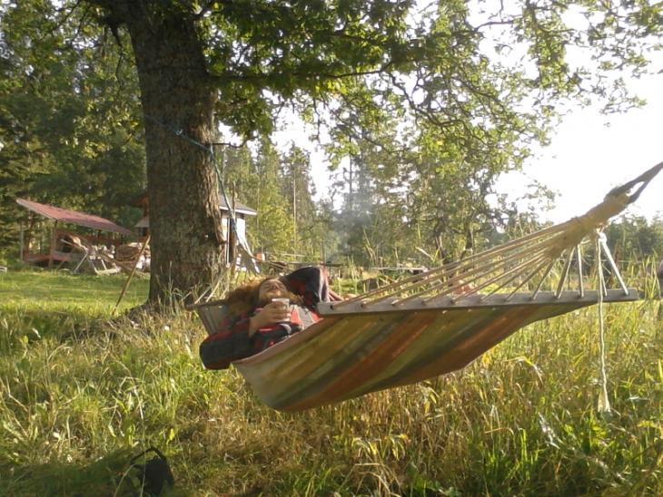Enjoying coffee in a hammock.
